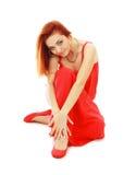 Woman sitting on a floor Stock Photo