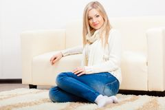 Woman sitting on the floor Stock Photos