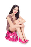 Woman sitting on the floor. With a bag Royalty Free Stock Photography