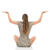 Woman Sitting On A Floor With Arms Outstretched. Rear View Stock Image