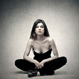 Woman sitting on the floor Stock Image