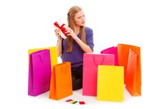 Woman sitting on the floor behind shopping bags Stock Photos