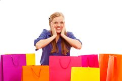 Woman sitting on the floor behind shopping bags Royalty Free Stock Photos