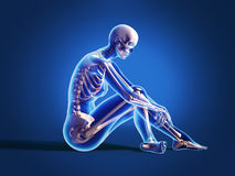 Woman sitting on floor, with bone skeleton. Stock Images