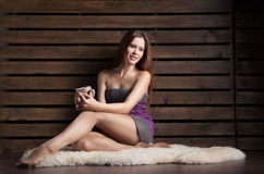 Woman sitting on the floor with cup of coffee Stock Images