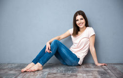 Woman sitting on the floor. Happy beautiful woman sitting on the floor Royalty Free Stock Image