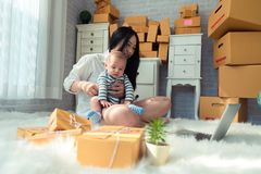 Woman Sitting on Floor While Holding Baby stock photos