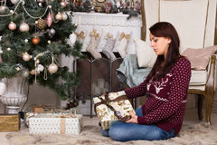 Woman Sitting on the Floor Holding Gift Box Royalty Free Stock Images