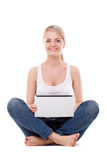 Woman sitting on the floor with laptop Royalty Free Stock Photos