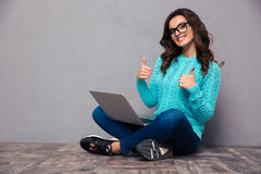 Woman sitting on the floor with laptop Royalty Free Stock Photo