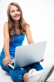 Woman sitting on the floor with laptop Stock Photography