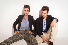 Woman sitting on the floor next to her lover Royalty Free Stock Photos