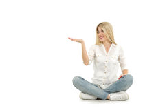 Woman sitting on the floor and pointing with her finger royalty free stock photo