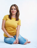 Woman sitting on a floor. Royalty Free Stock Photos