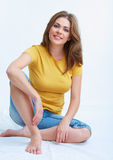 Woman sitting on a floor. Stock Images