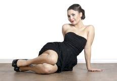 Woman sitting on the floor Stock Photos