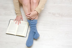 Woman sitting on the floor reading a book Royalty Free Stock Photo