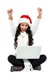 Woman sitting on the floor rejoicing looking at laptop Royalty Free Stock Photo