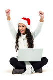 Woman sitting on the floor rejoicing looking at laptop Royalty Free Stock Images