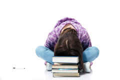 Woman sitting on the floor and sleepiing on books Stock Images