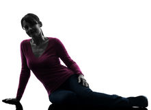 Woman sitting on floor smiling full length silhoue Stock Image