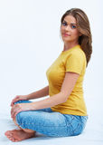 Woman sitting on floor Stock Photos