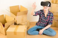 Woman sitting on floor with VR headset device Stock Image