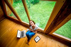 Woman sitting on the floor in wooden house Stock Photography
