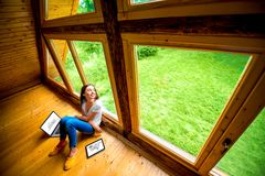Woman sitting on the floor in wooden house Royalty Free Stock Photos