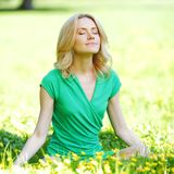 Woman sitting on flower field Royalty Free Stock Photography
