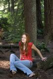 Woman sitting on forest floor Royalty Free Stock Photography
