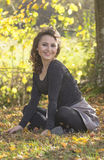 Woman sitting in the forest Stock Photo
