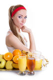 Woman sitting with fresh juices and fruits Royalty Free Stock Photos