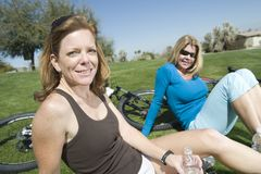 Woman Sitting With Friend In Park Stock Image
