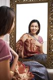Woman sitting in front of mirror Royalty Free Stock Images