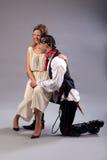 Woman sitting fun on knee man pirate Royalty Free Stock Photo