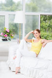 Woman, sitting, girl, couch, home, sofa, room, beautiful, teenage, white, relaxing, smartphone, young, female, attractive, leisure Royalty Free Stock Images