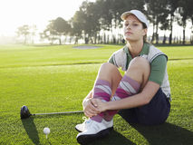 Woman Sitting On Golf Course Royalty Free Stock Image