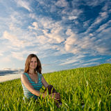 Woman sitting on grass Royalty Free Stock Image