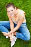 Woman sitting on grass Stock Image