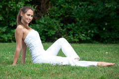 Woman sitting on the grass Stock Photography