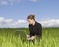 Woman sitting in the grass Royalty Free Stock Photo