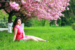 Woman sitting on a grass Stock Photography