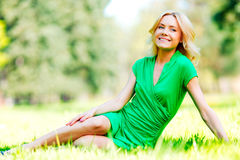 Woman sitting on grass Royalty Free Stock Photos