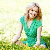 Woman sitting on grass stock photos