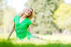 Woman sitting on grass Royalty Free Stock Photo