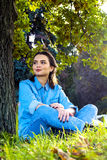 Woman sitting on the grass stock photo