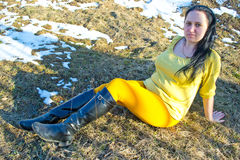 Woman sitting on the grass last year Royalty Free Stock Photos