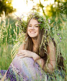 Woman sitting on grass in park Royalty Free Stock Image