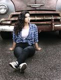 Woman Sitting on Gray Pavement Near Vintage Gray and Brown Car Stock Photos